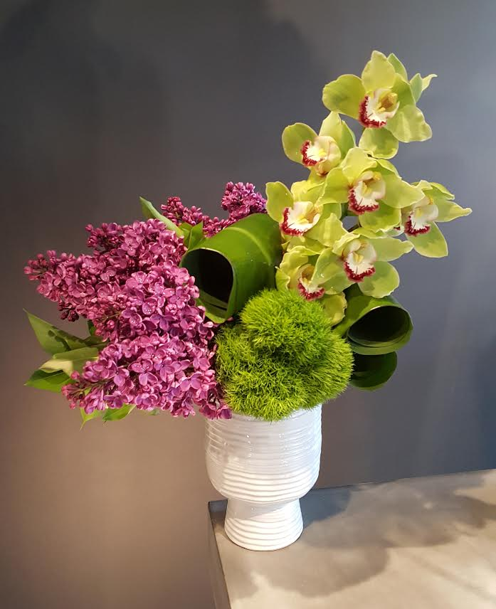 Vibrant orchid and lilac arrangement for office decor