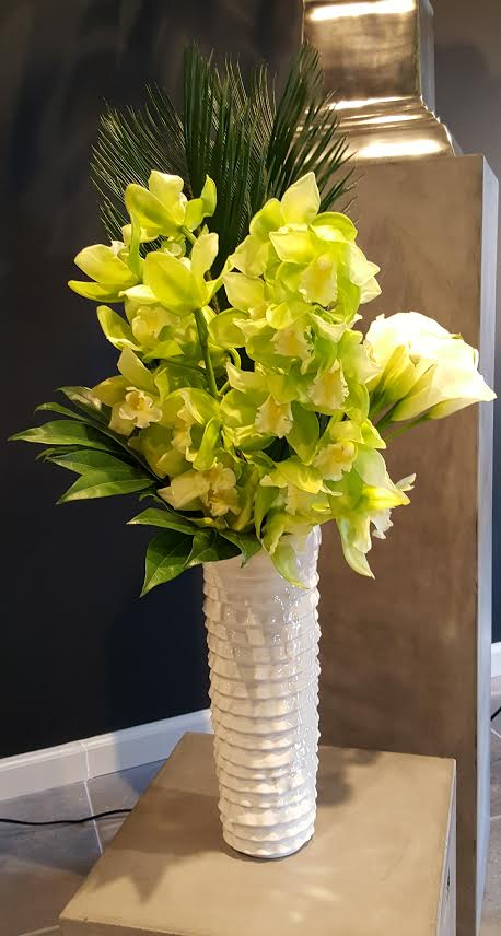 Green-ish flowers in white vase for restaurant or corporate decor