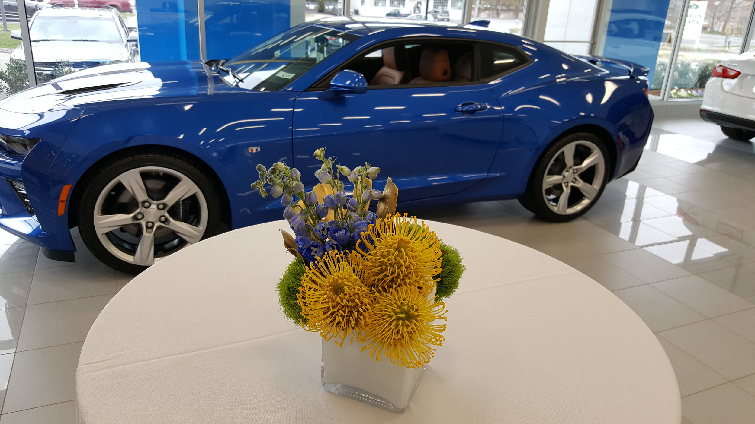 Car dealership floral designs are available from Bouquets & Beyond