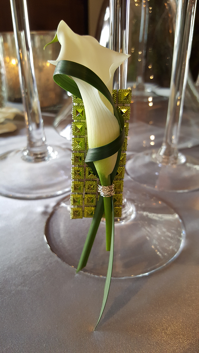 Flower in simple vase on table at a wedding