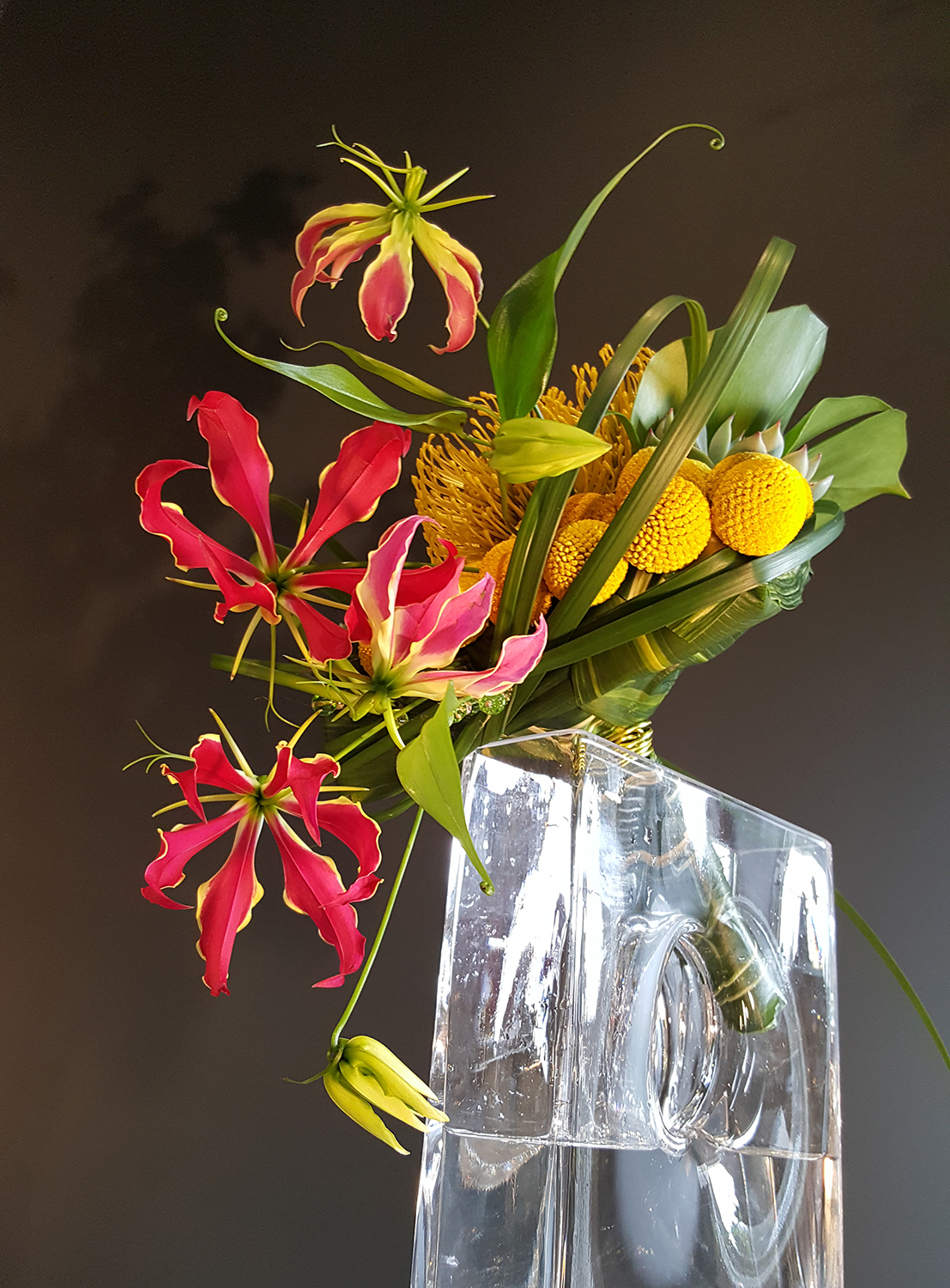 Exotic and funky vase of pink and yellow flowers