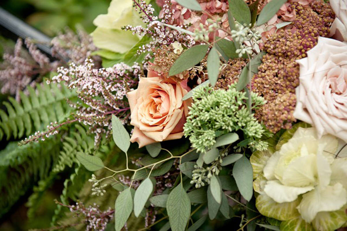 Elegant flowers in an arrangement designed by Bouquets & Beyond