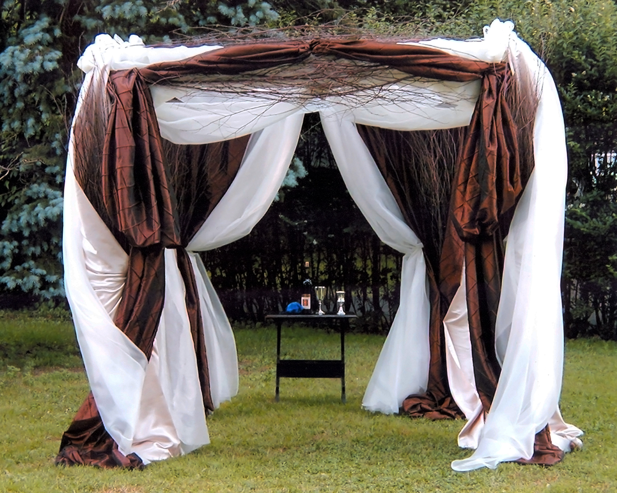 Wedding arch covered with layers of fabric