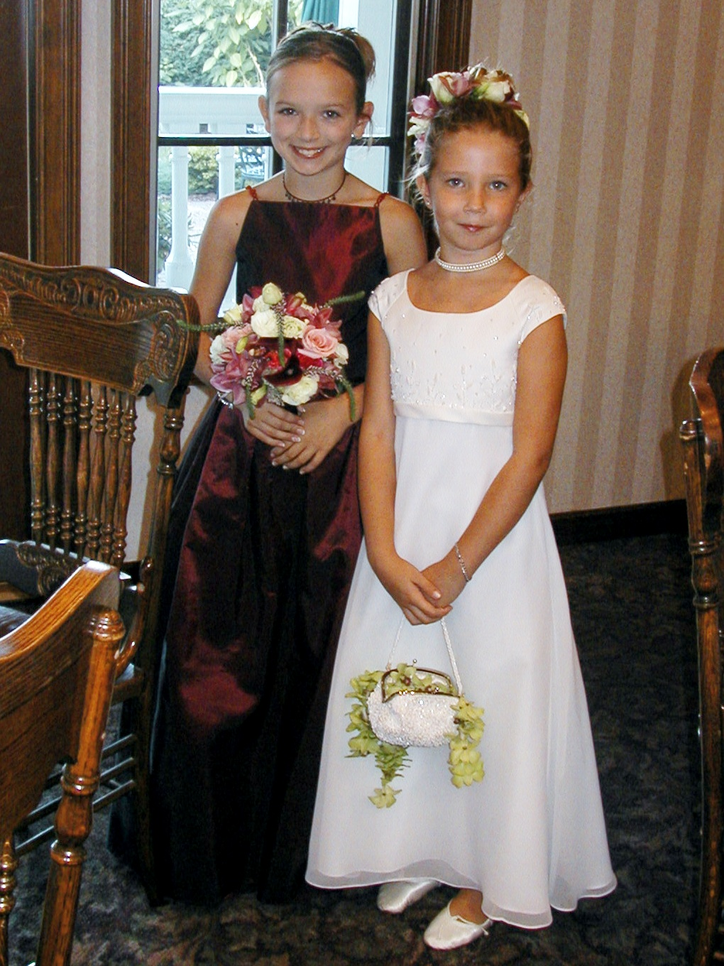 Flower girls with flowers in bouquet and basket from Bouquets & Beyond