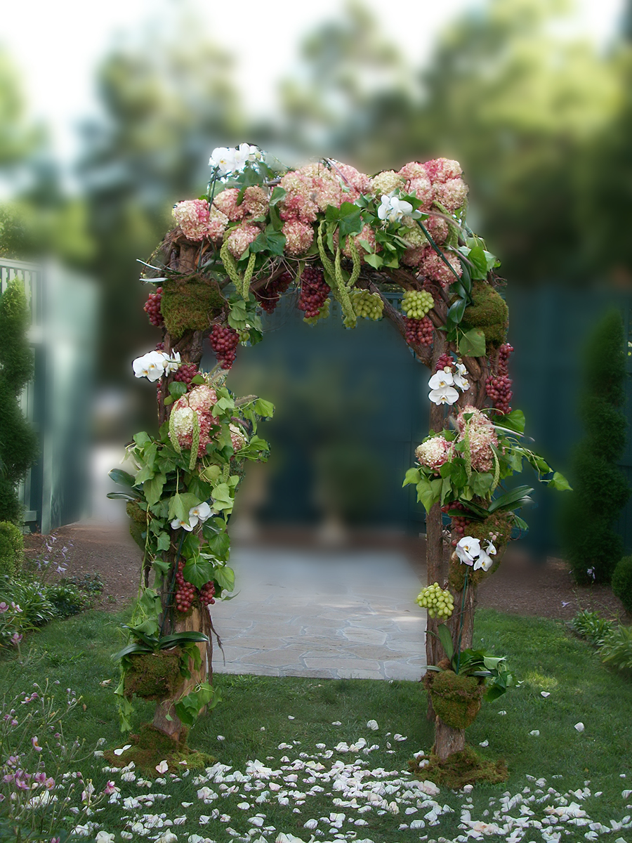 Wedding alter decorated in elegant florals from Bouquets & Beyond