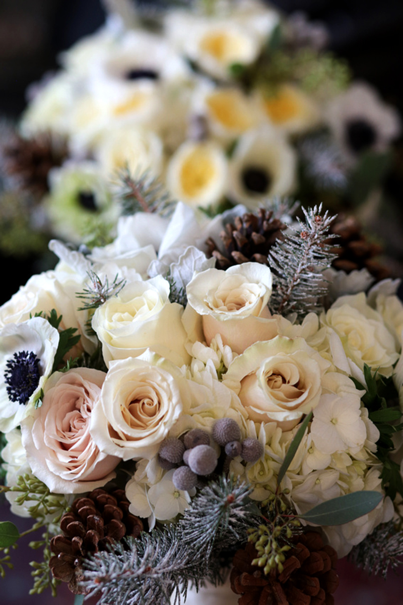 Elegant florals designed for a wedding by Bouquets & Beyond