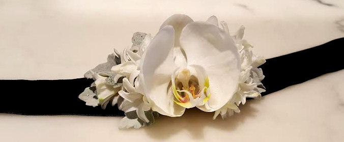 Simple orchid flower decor provided by Bouquets & Beyonds Florals of Woodbury