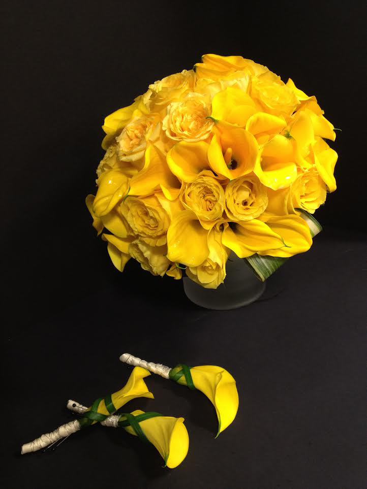 Yellow flowers in a vase for a wedding designed by Bouquets & Beyond
