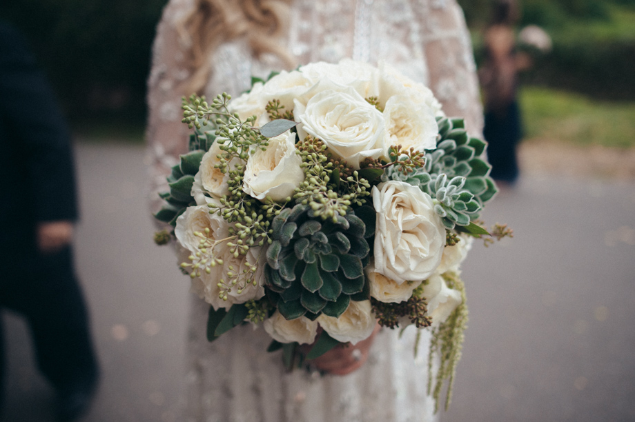 White roses and succulents in a bridal bouquet from Bouquets & Beyond