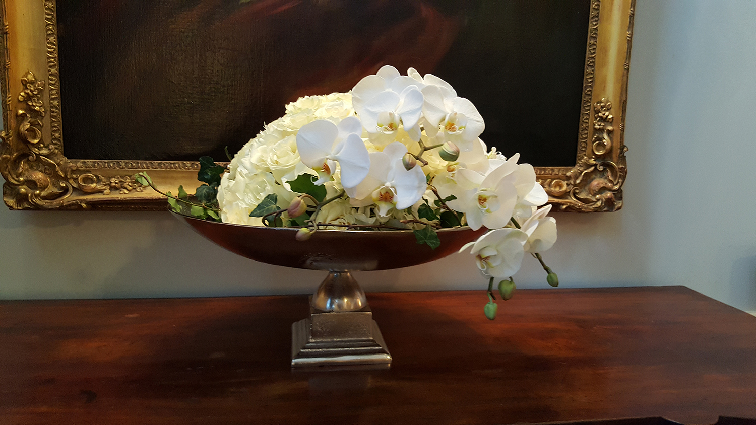 White flowers in bowl designed for office environments