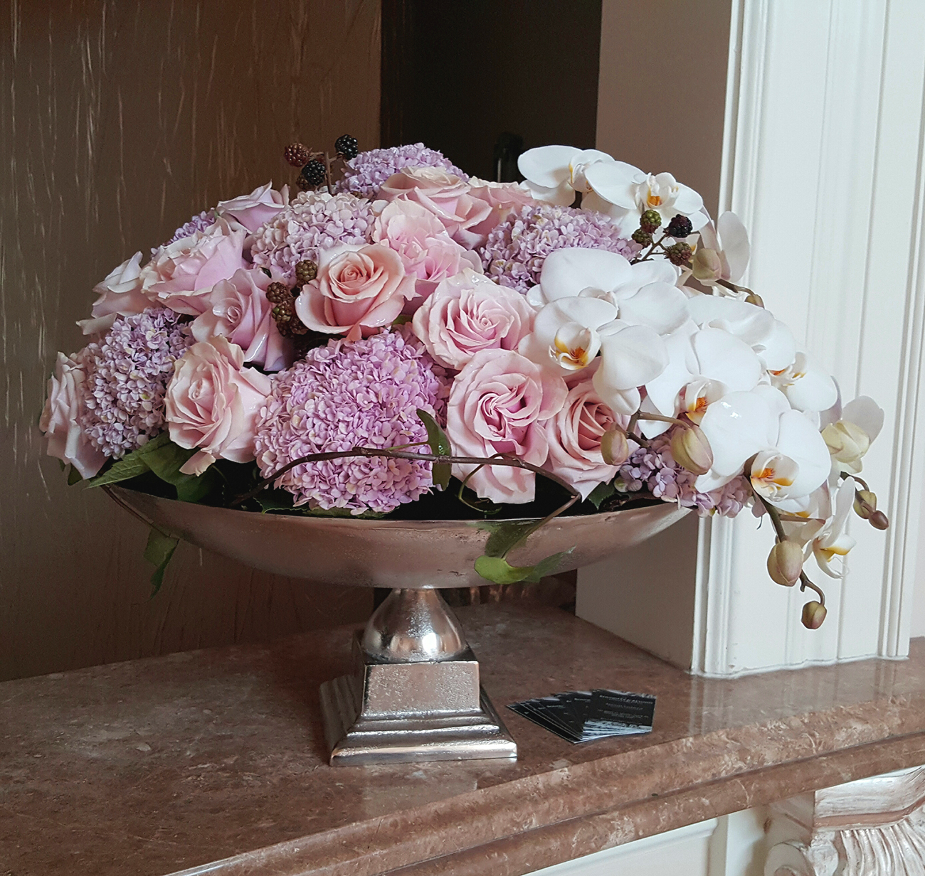 Pink and purple flower arrangement for event or everyday decor