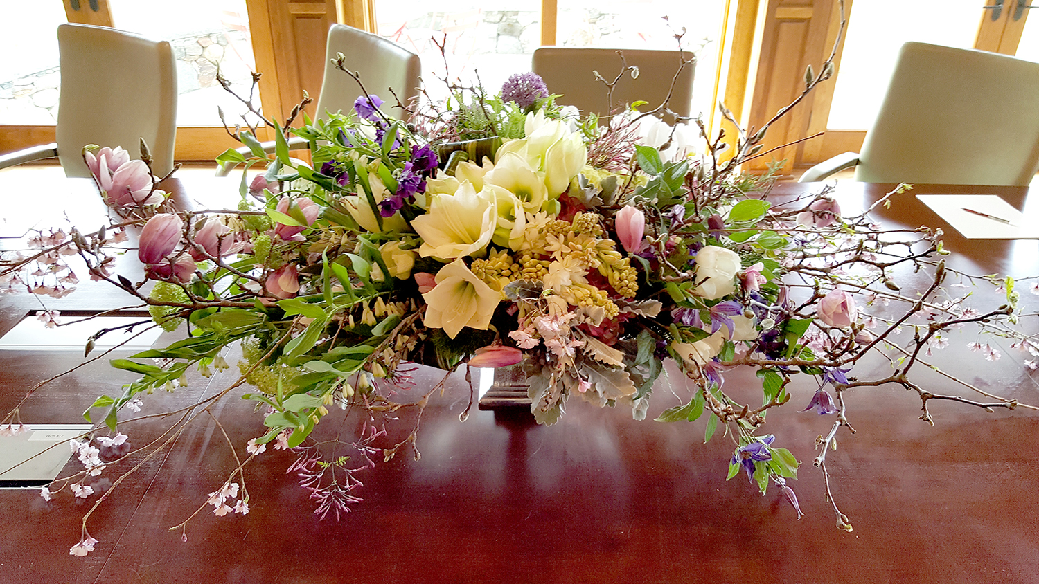 Conference room table centerpieces by Bouquets & Beyond