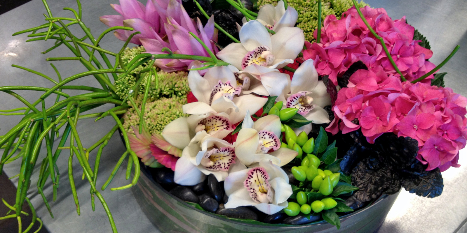 Pink and green flower arrangements for corporate spaces or events