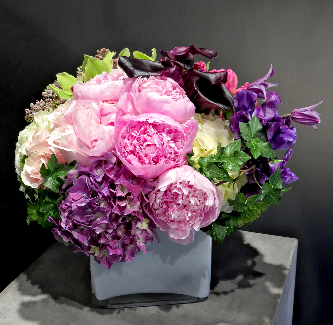 Pink, purple and green flowers designed for restaurant decor by Bouquets & Beyond in Woodbury