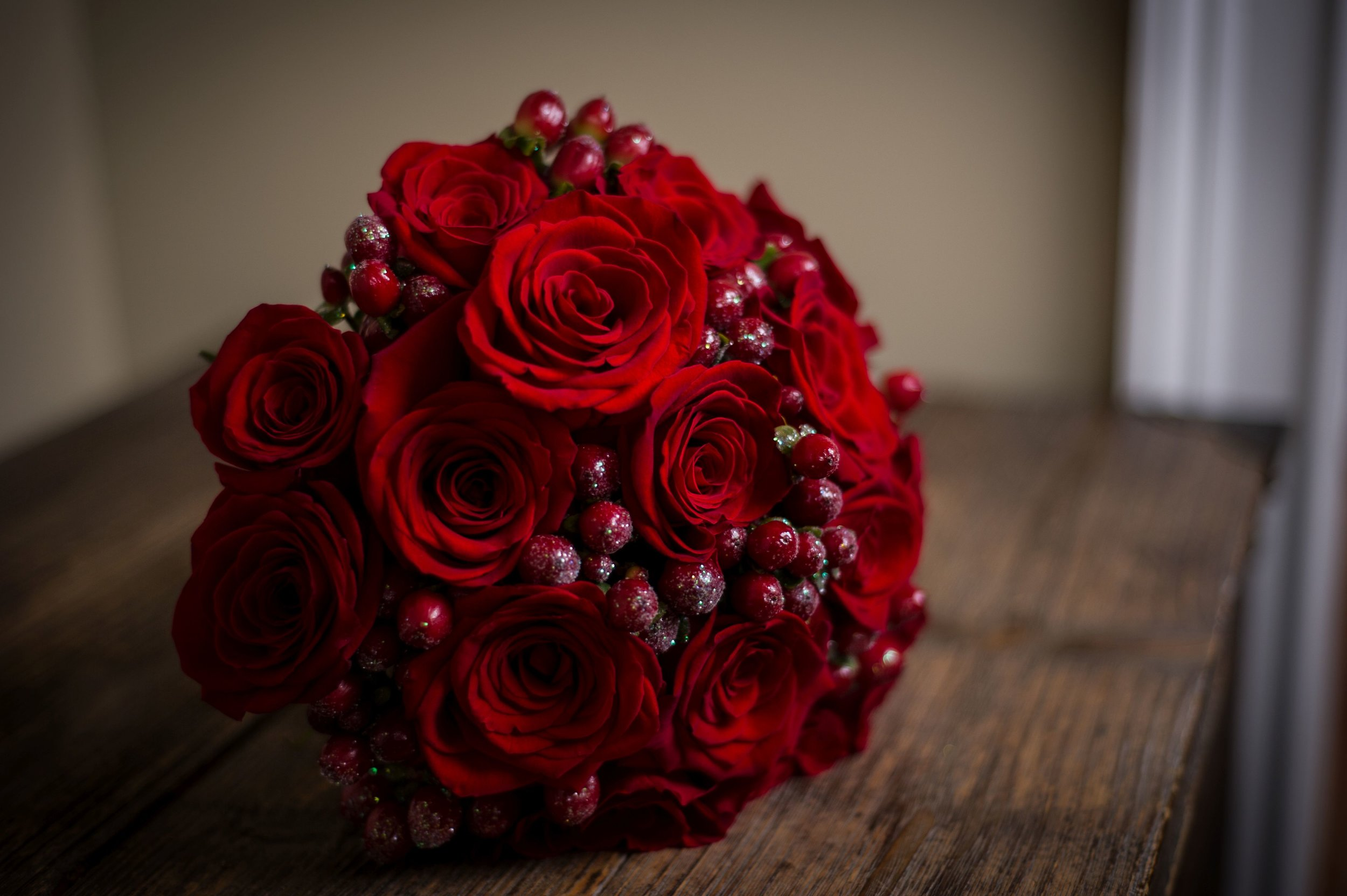 Red Roses and cranberries bridal bouquet from Bouquets & Beyond of Woodbury CT