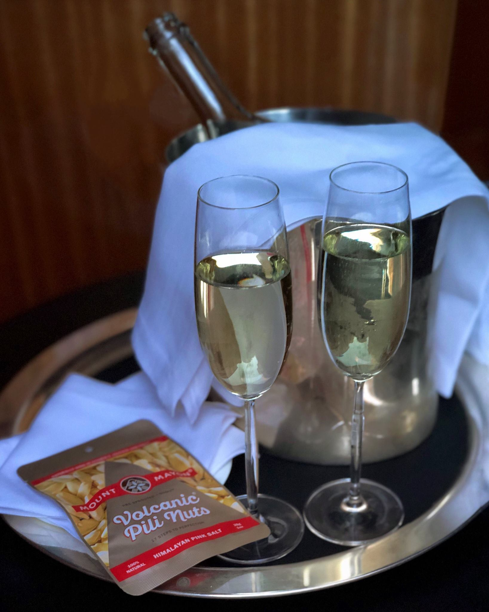 Himalayan Pink Salted Pili Nuts with a nice chilled glass of Prosecco.jpg