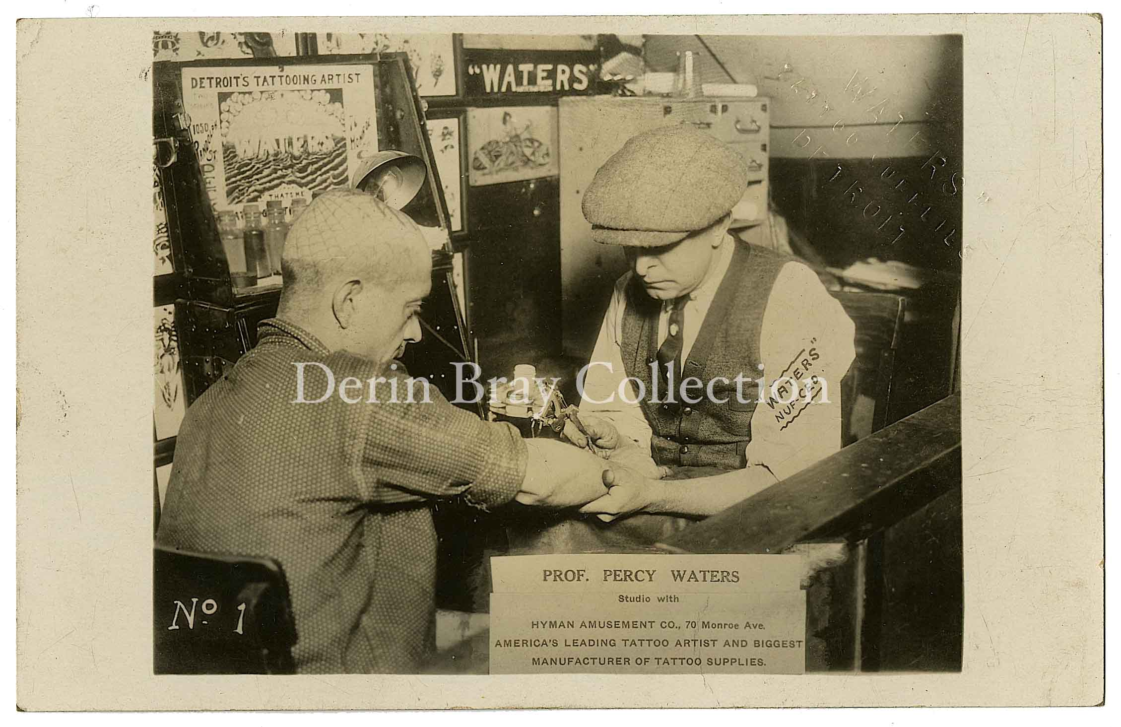 Percy Waters tattooing Ed Van, photo postcard, Detroit, ca. 1925.  Derin Bray Collection