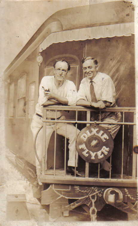 Photo postcard of Victor Herfel (R), probably taken in a Baltimore arcade. Both he and Eddie Levin worked at 420 East Baltimore Street, home to Playland penny arcade. The man on the left is unidentified, but appears to be holding paint brushes.  Private Collection