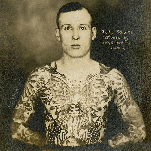 "Clarence ""Shorty"" Schultz (1891-1935) isn't a familiar name in tattoo history, but he rubbed shoulders with some of the greats. Around 1918, he quit his foundry job in Davenport, Iowa and made his way to Chicago for a fresh start in life. Schultz soon found himself in the capable hands of Professor William Grimshaw, a seasoned tattoo artist who was happy to set him on a new path. And so, from his winter headquarters in a South State Street arcade, Grimshaw covered his new canvas in fashionable designs. Just footsteps away tattoo newcomer Bert Grimm was putting in reps at Ward Burton's arcade at 434 South State Street. Evidently Schultz and Grimm hit it off. Both men ended up working at this location and Grimm even helped complete his suit. Click the profile link to see a photo of Shorty Schultz' back and to learn more about his time in Chicago and Davenport."