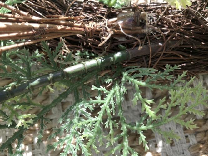 tucking succulent stems under floral wire.JPG