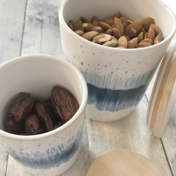 canisters with fresh almonds and dates.jpg