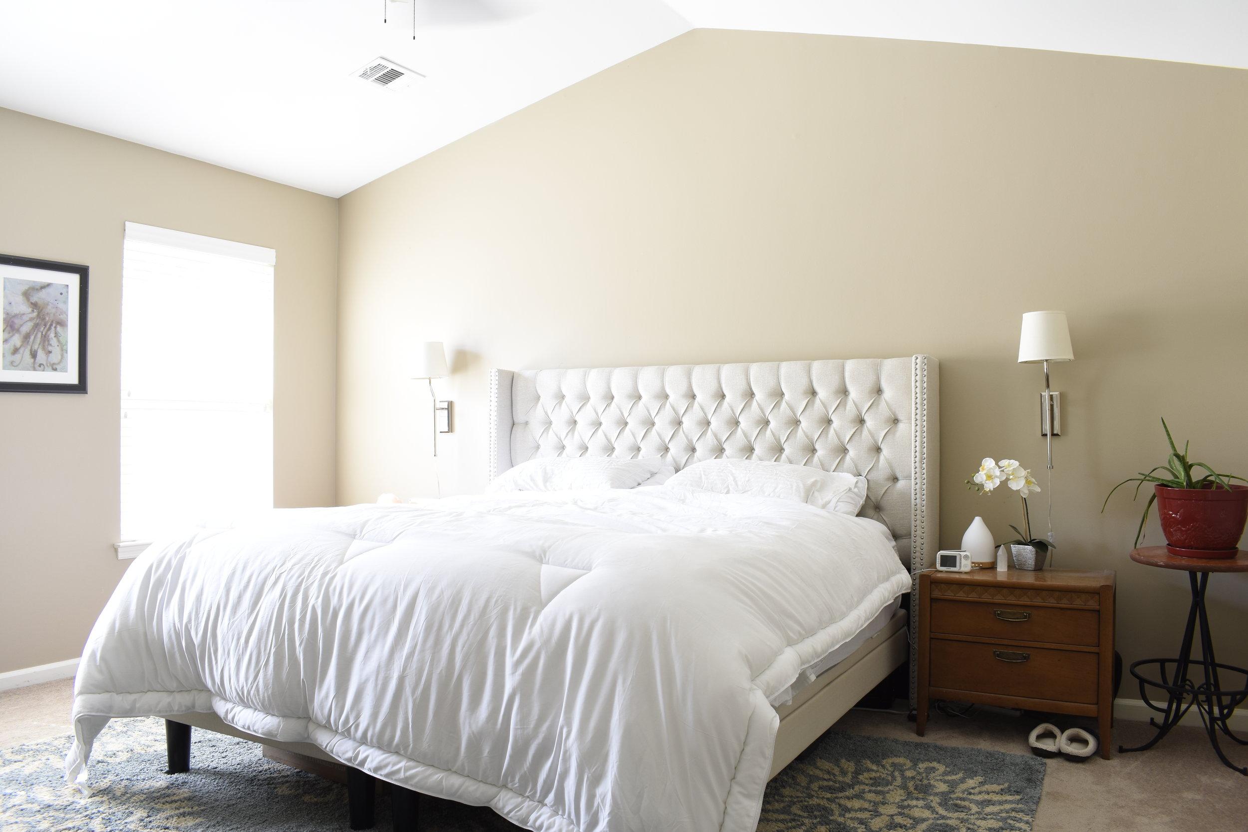 master bedroom neutral tufted headboard.JPG