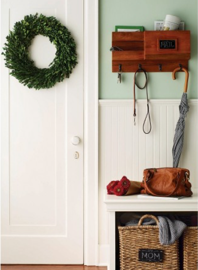 boxwood wreath hanging inside mudroom