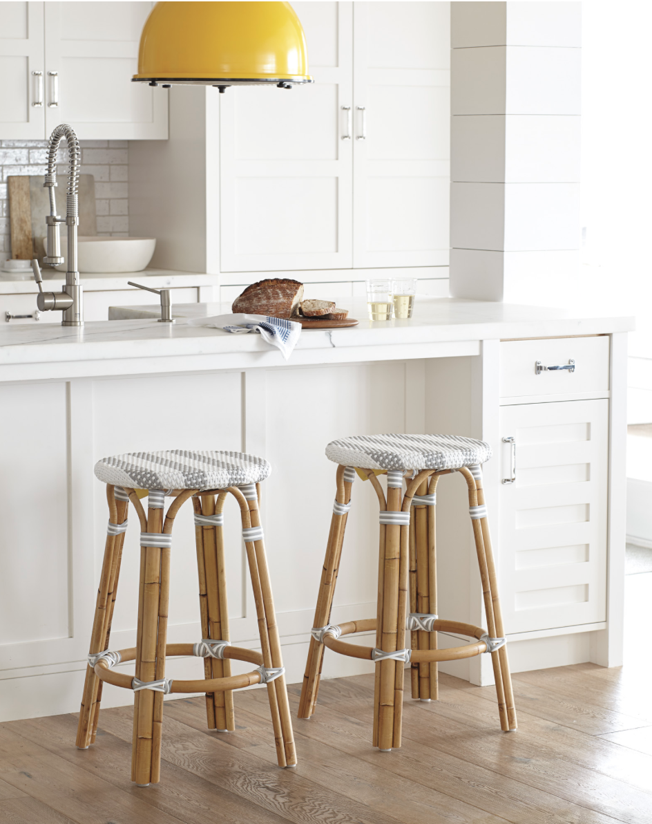 modern white cottage kitchen with bright pop of yellow - this pendant just makes the whole space