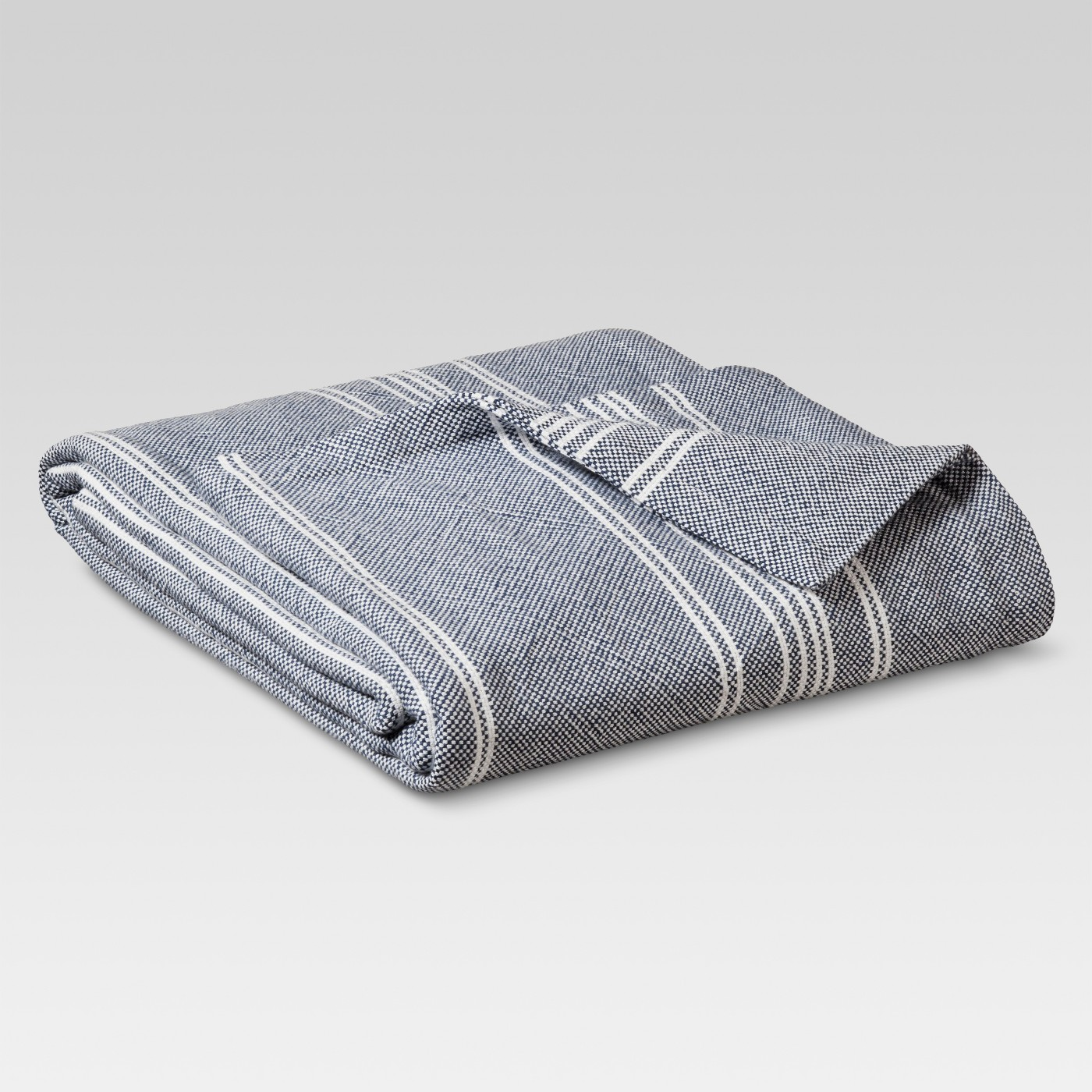 navy and white striped blanket for fall update your bedding