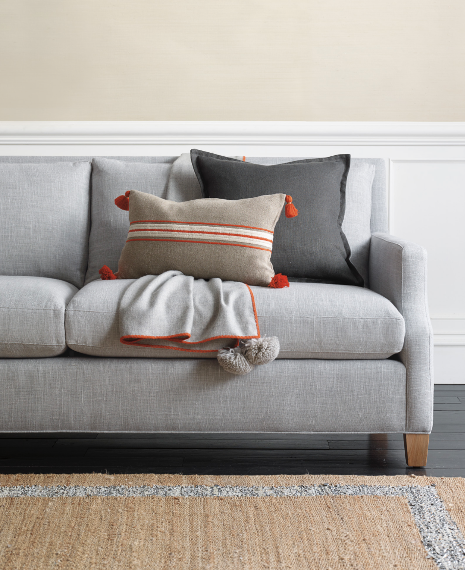 obsessed with this throw as a little wink at fall in a modern living room