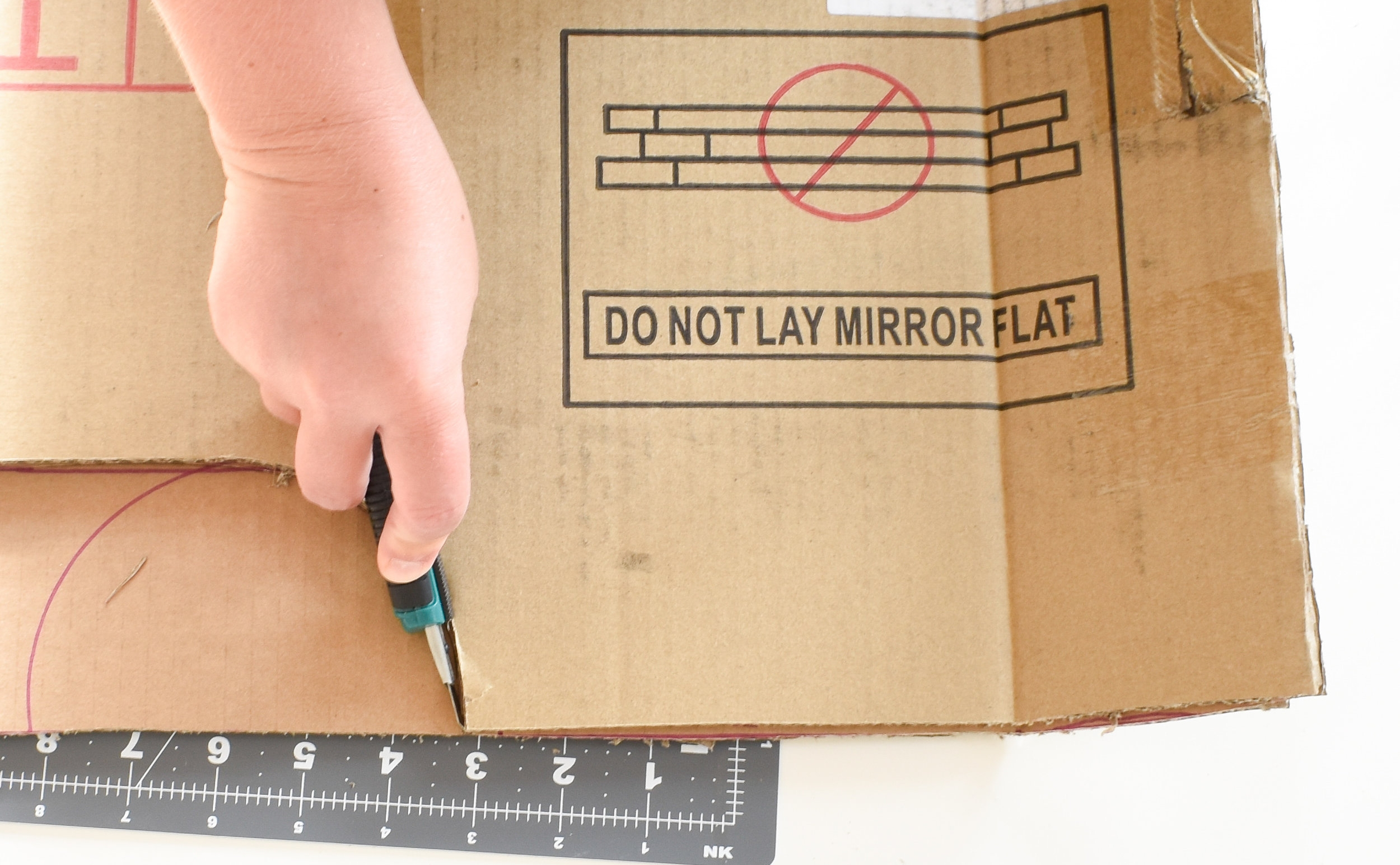 how to cut identical arches in your DIY cardboard cornice board