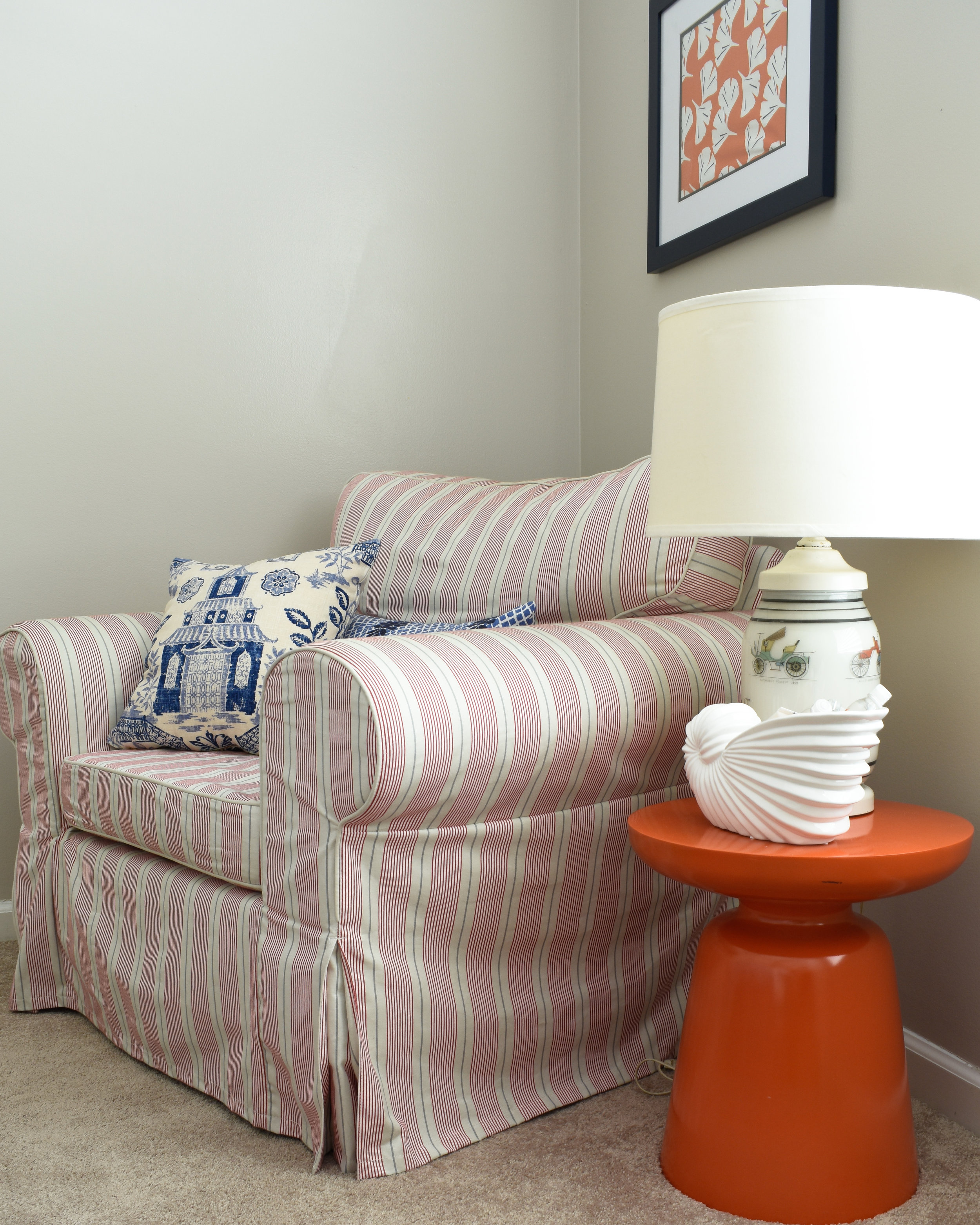 navy blue and orange bring colorful chinoiserie style in this bedroom seating area