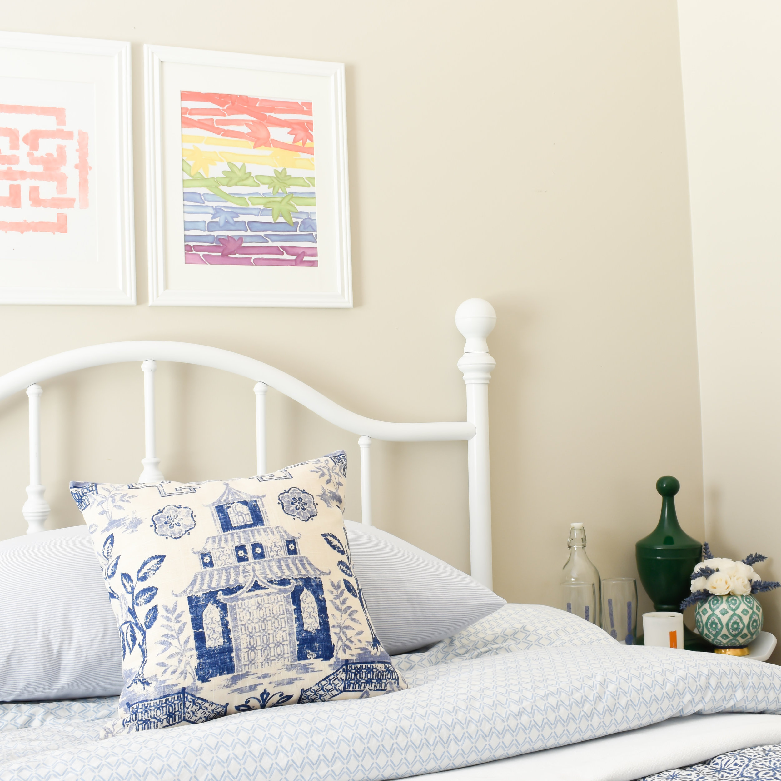 colorful artwork brings playfulness to this blue and white bedroom