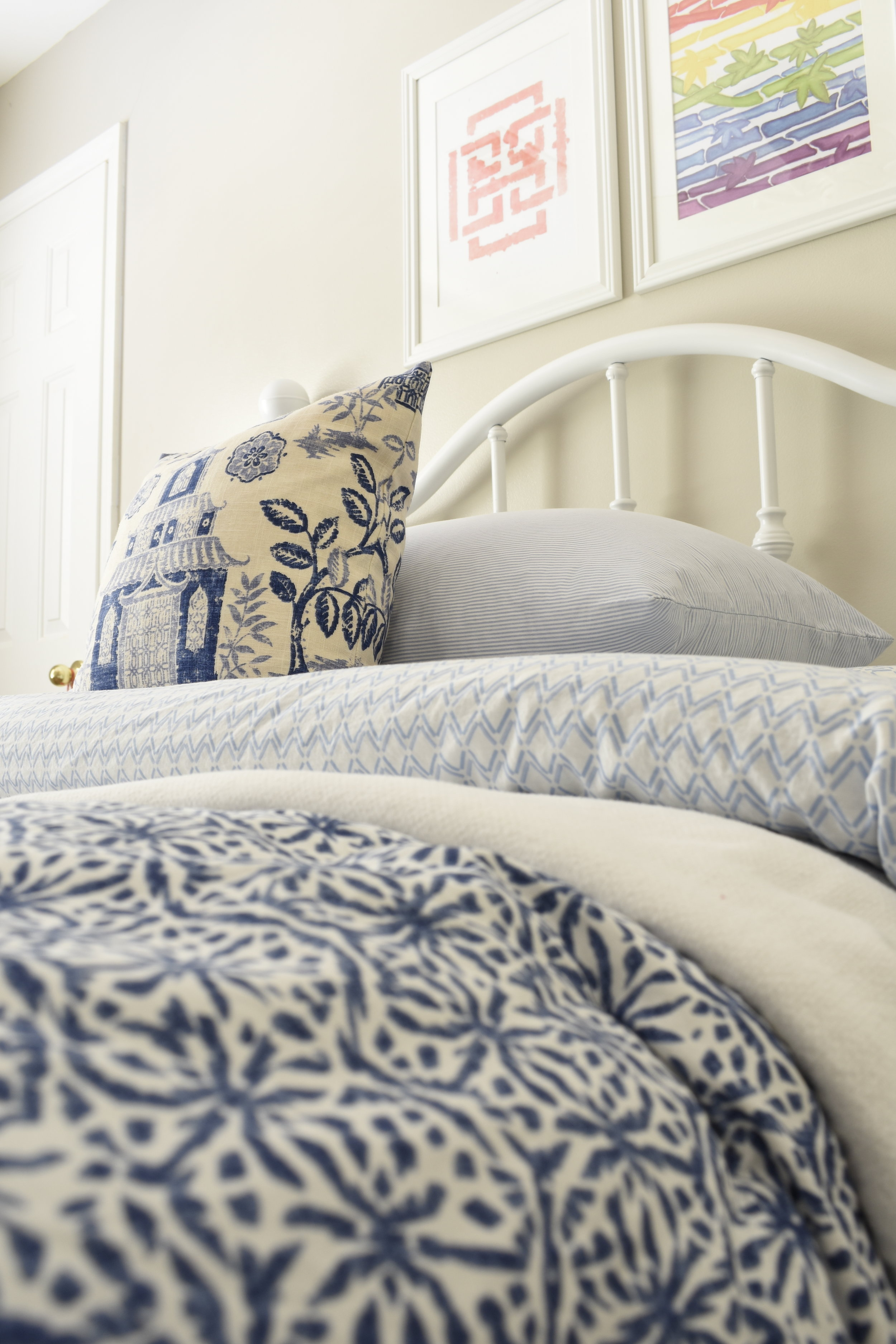 blue and white bedroom gets an update with colorful chinoiserie artwork