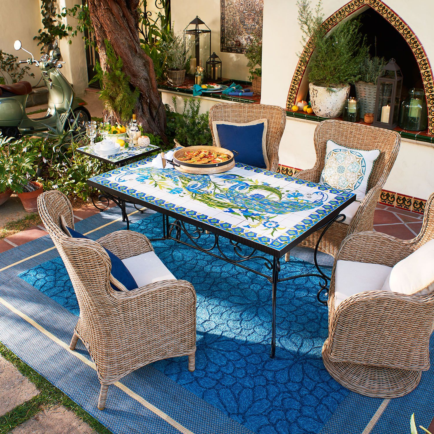coastal bohemian dining area with woven armchairs.