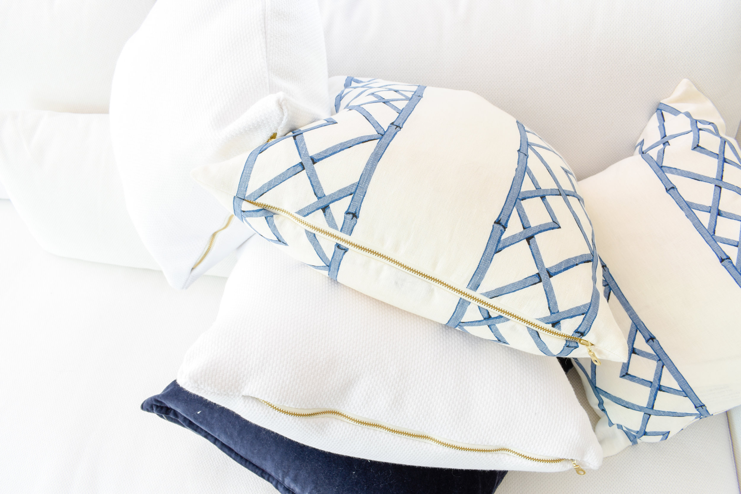 chinoiserie style throw pillows in blue and white