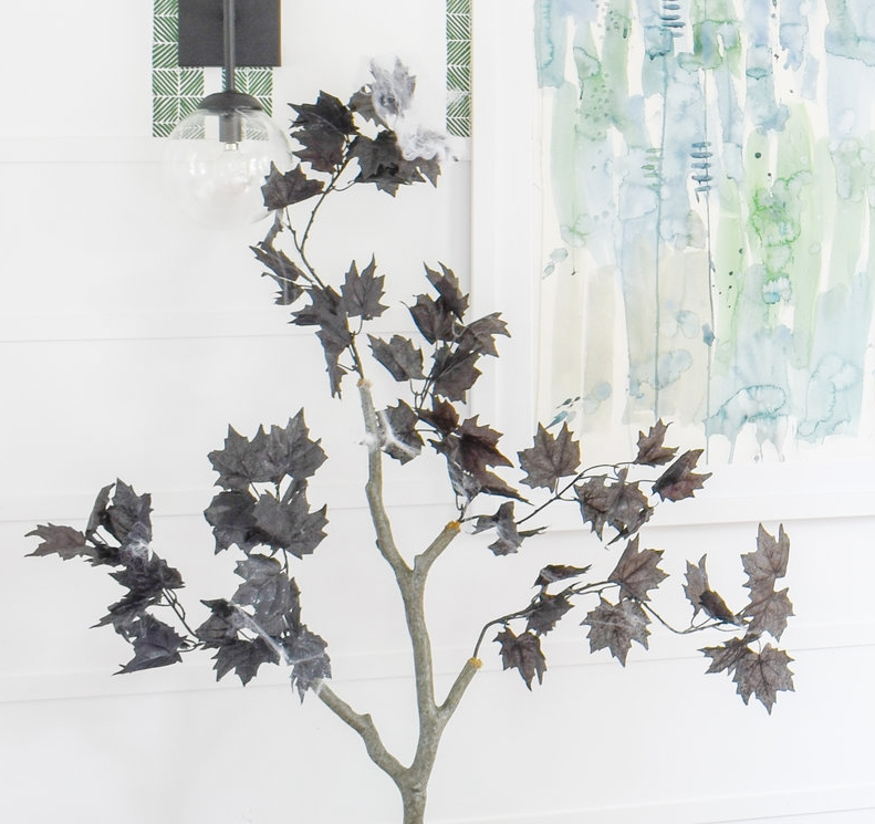 turn your faux houseplants into sinister trees using halloween florals from the dollar store