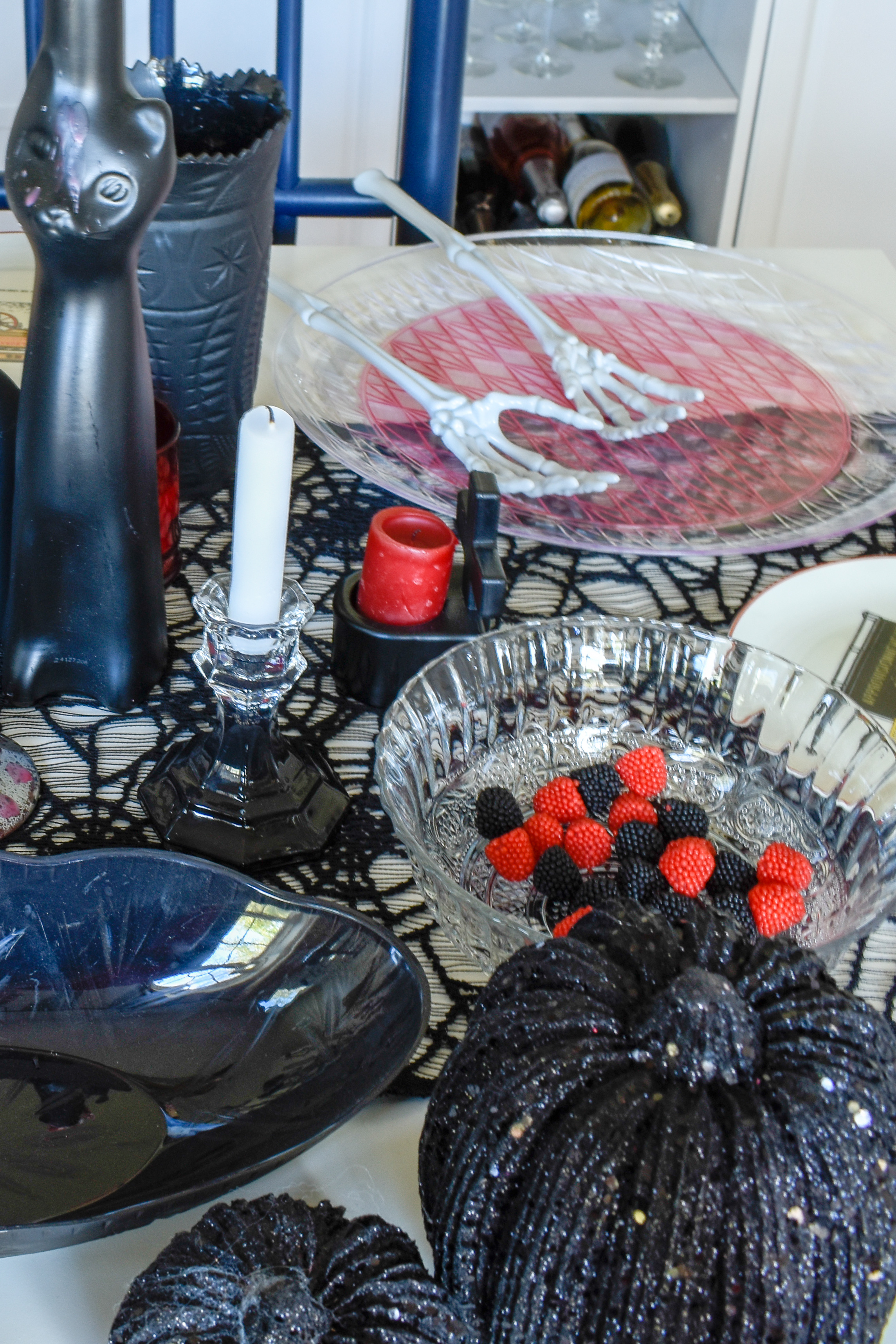 Easy Halloween Party Table Setting - I like to keep it buffet style. Let people walk around. Adding black and red accents makes this neutral but spooky.