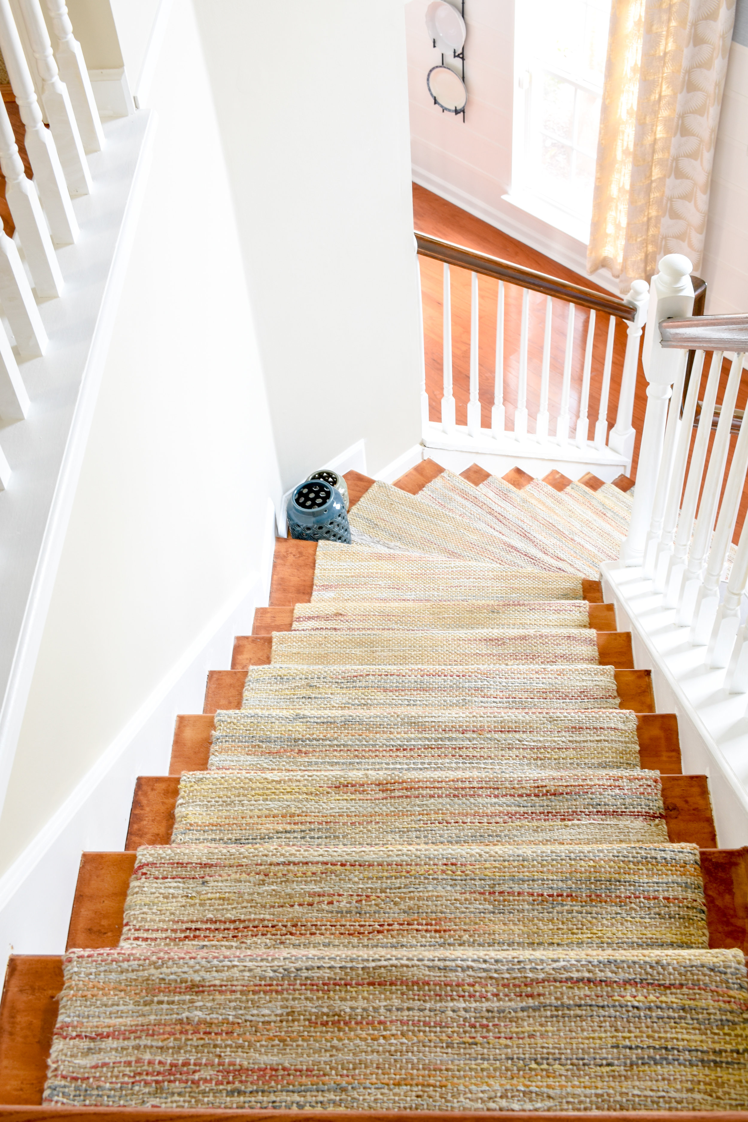 hardwood stairs with permanent runner rug installed