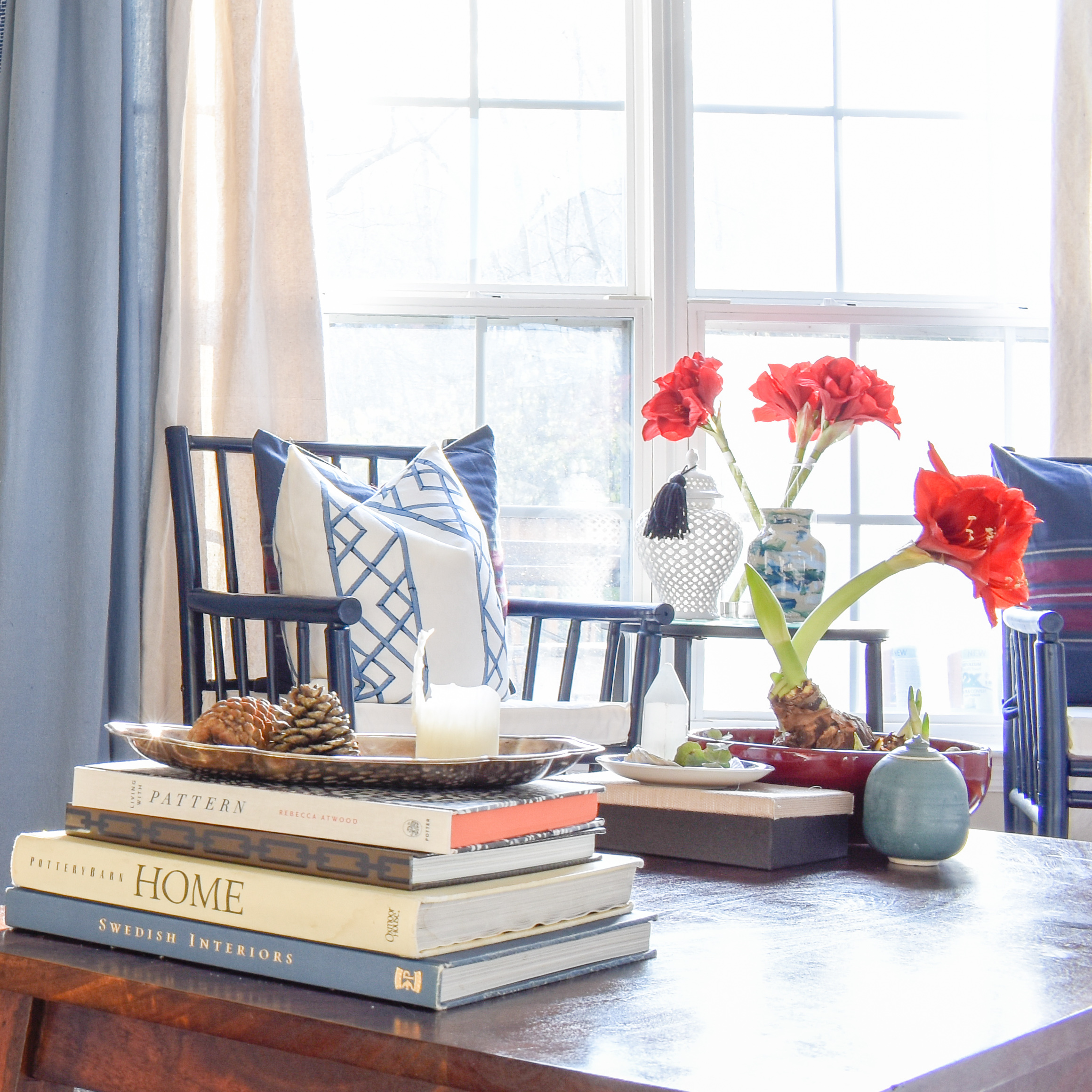 Christmas Home Tour: How To Decorate with Traditional Holiday Decor On A Budget | red amaryllis makes a festive statement when paired with varying shades of blue for Christmas decor. These plants last all season long and can remain well into the new year.