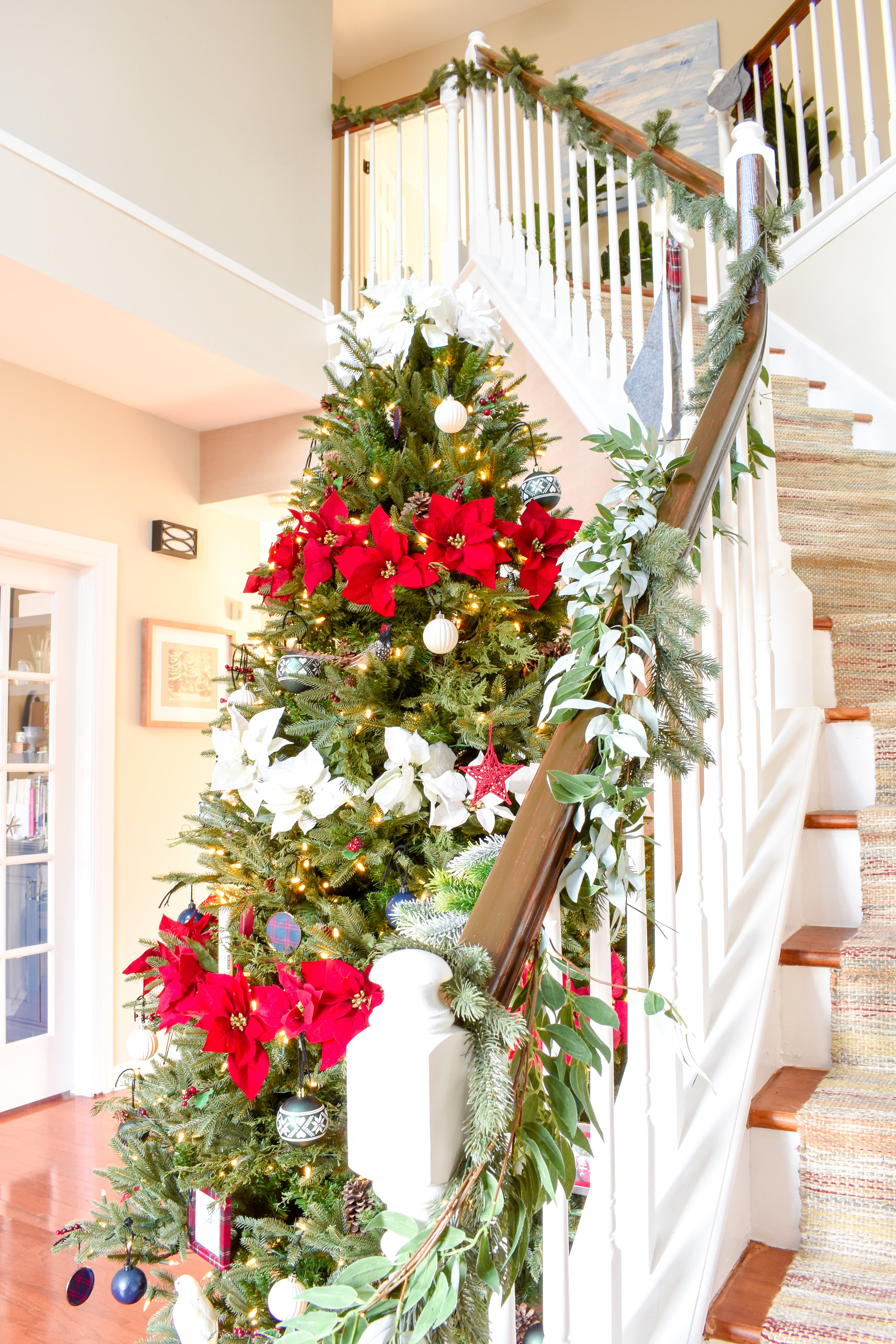 Traditional Christmas Decor - adding simple garland to your stair railing creates a lovely ambiance.