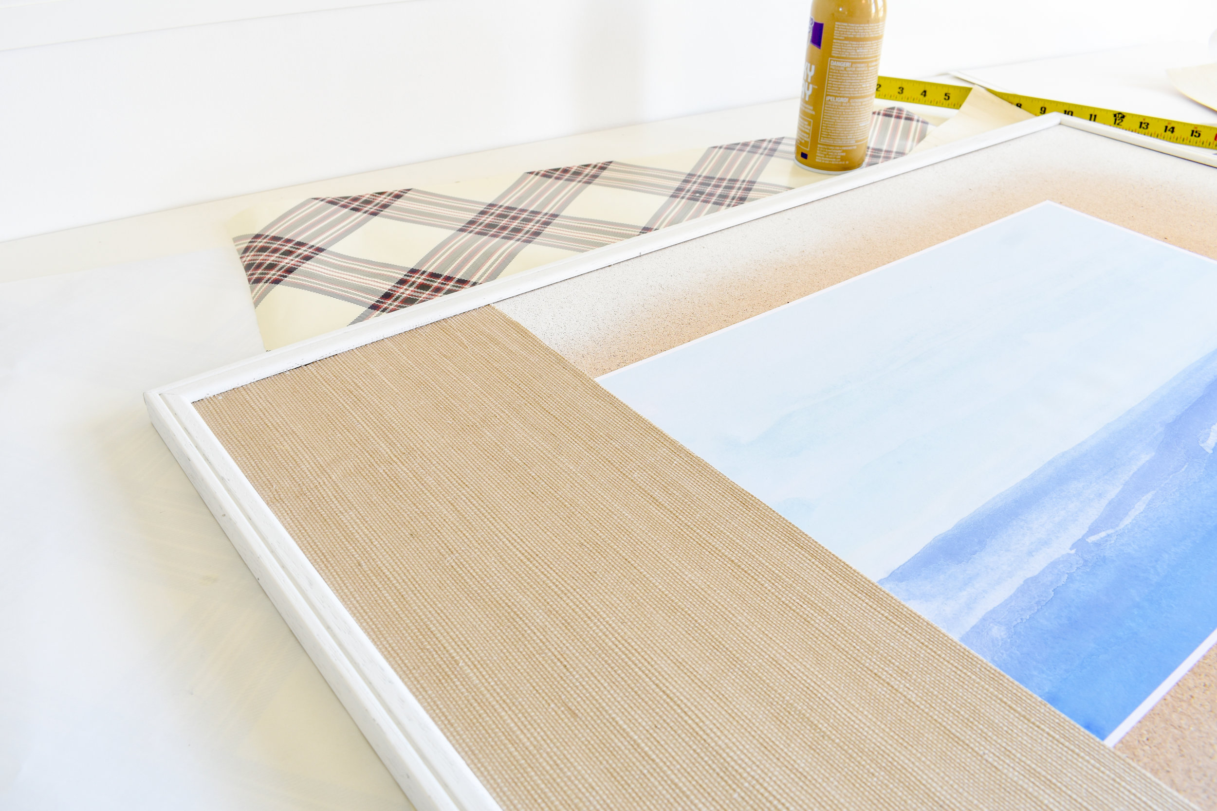 How to turn old wallpaper or wrapping paper scraps into custom matting for artwork. Here, I've used grasscloth wallpaper scraps to create a custom look that would cost hundreds to have made.