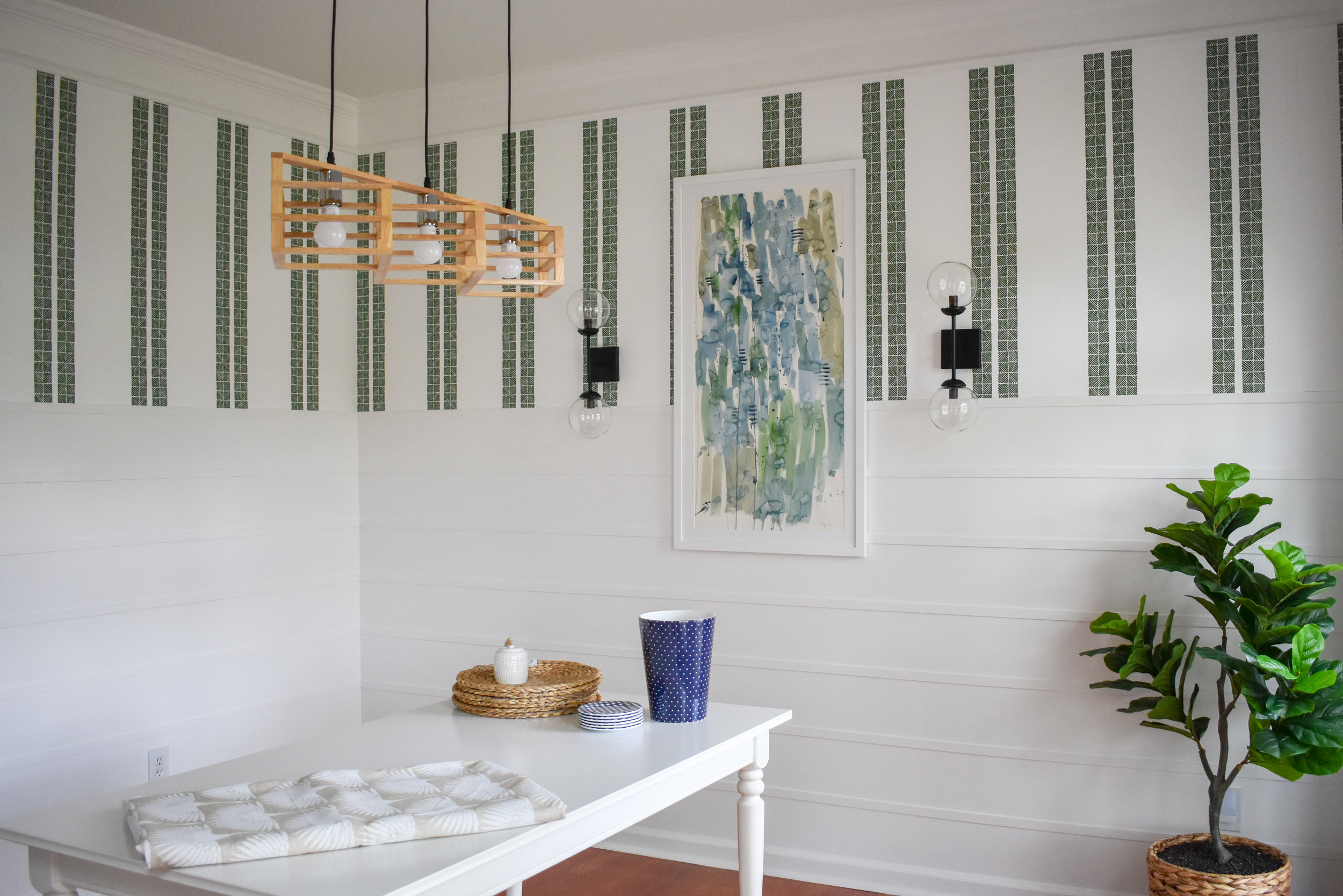 How To Install Horizontal Board And Batten: My Modern Shiplap DIY Knockoff On The Cheap | Here's how I installed this modern wainscoting in my dining room for under $200! #moderntrimideas #shiplapaccentwall #modernwainscotingtrends