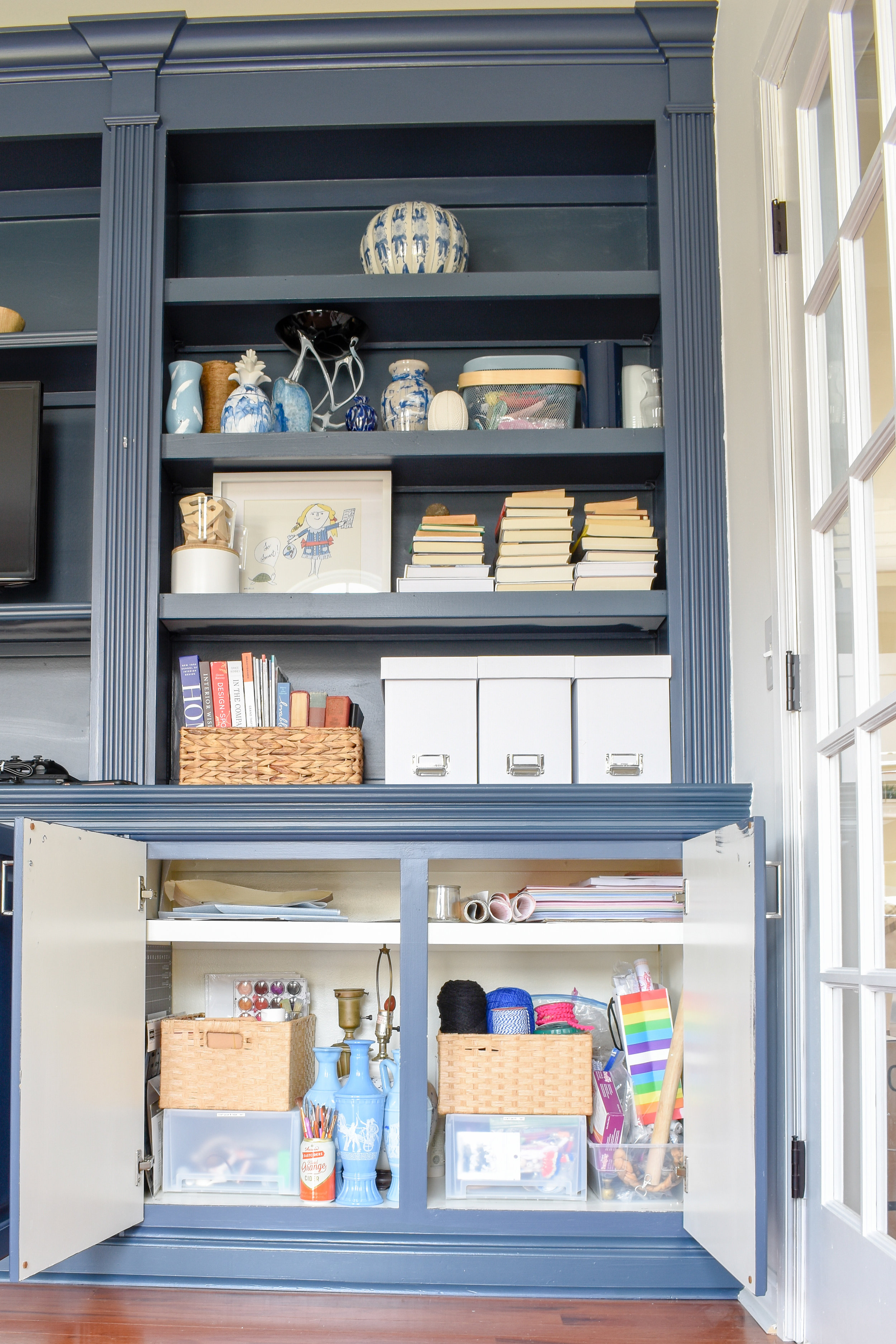 Home Office Storage Ideas - I display my shop's inventory in open shelving that's easy to access and charming.