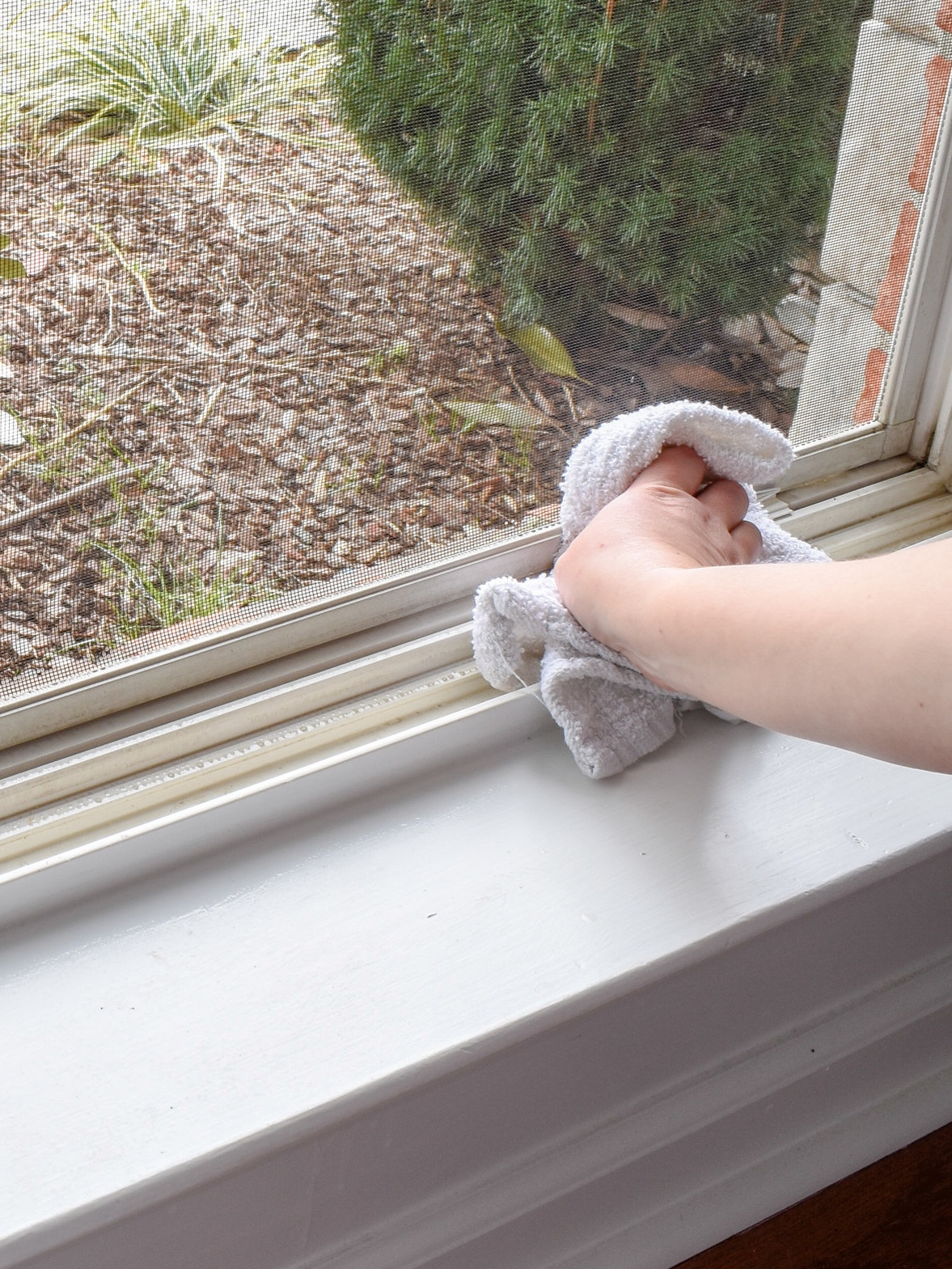 Cleaning Vinyl Windows: Step Four: Scrub each crevice, while wet with cleaning solution, using an old toothbrush or cleaning brush. Since my windows are vinyl and have begun to discolor, I also added a dap of toothpaste to brighten the plastic.