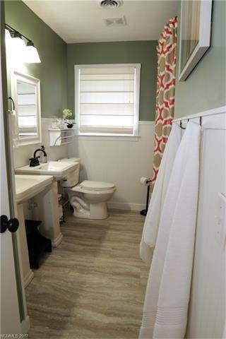 installing vinyl tile over existing tile in a bathroom