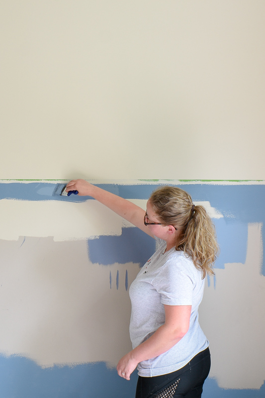 Using upward strokes, (towards the seam of the painter's tape), paint the edge of the painter's tape in the wall color you used prior. Painter's tape will always bleed but when you apply the existing wall color BEFORE your accent color, you're insuring the bleed will blend.