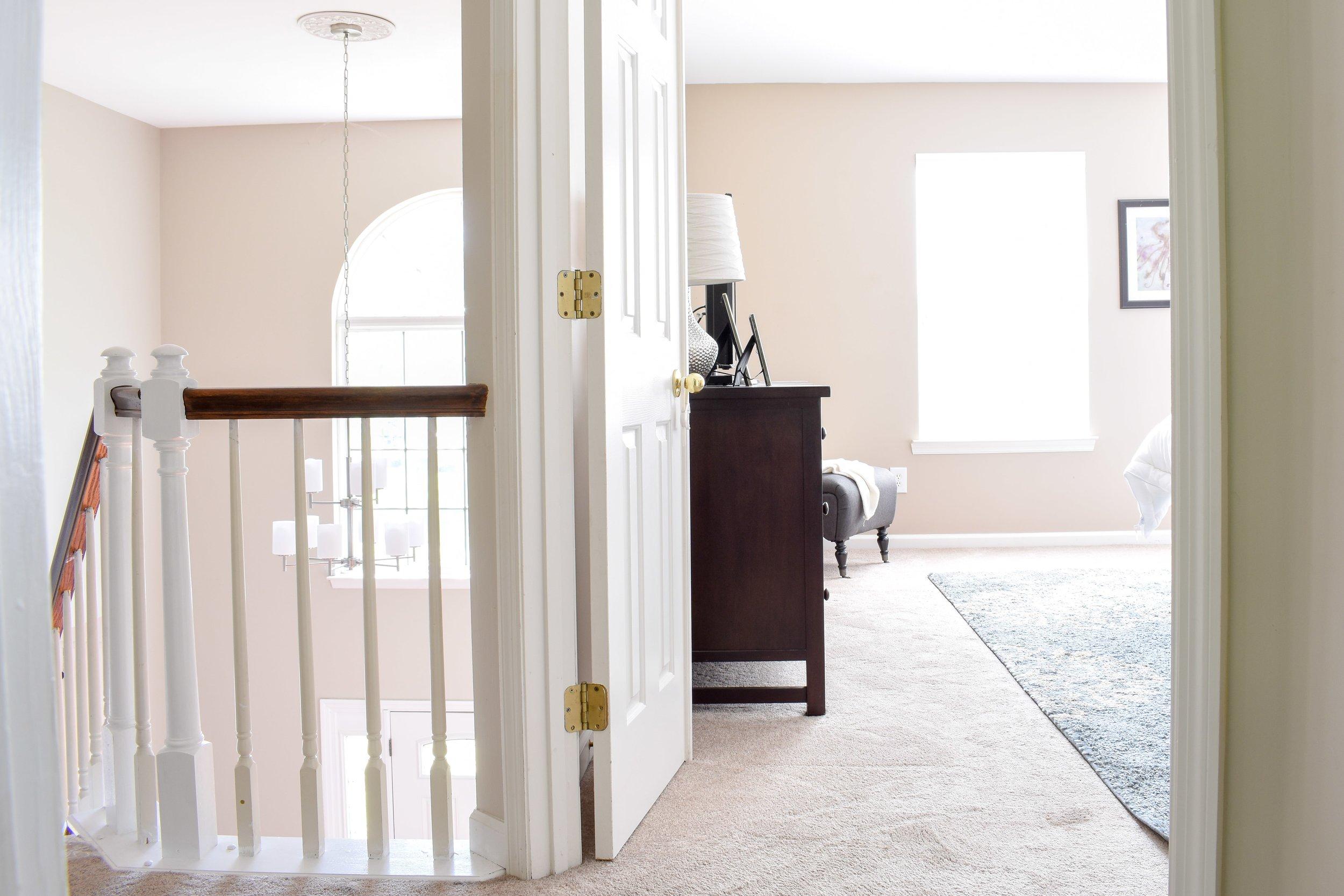 lofted upstairs hallway leading to master bedroom