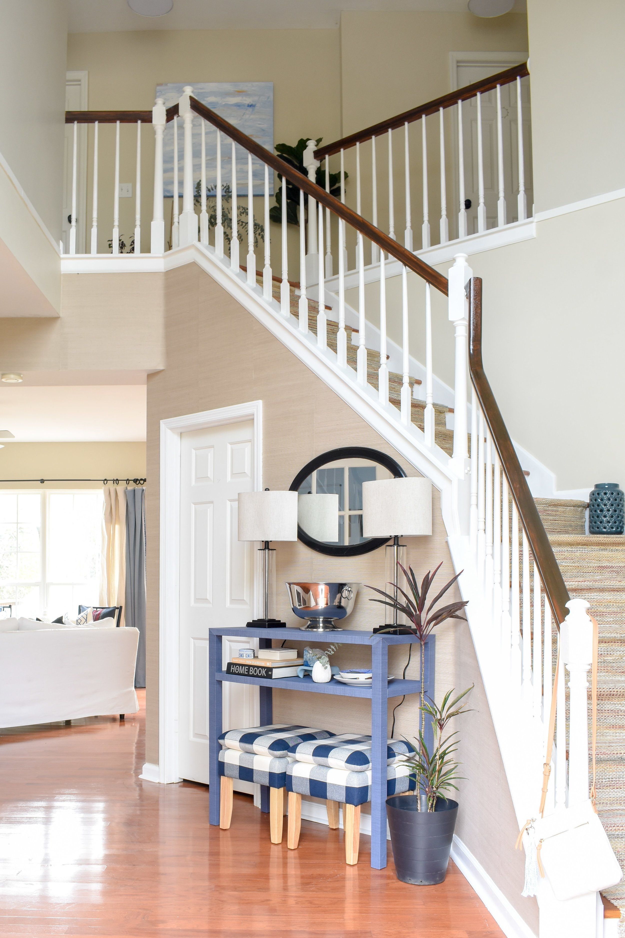 open two story foyer in a traditional suburban home - here's how we updated this space to make it feel fresh