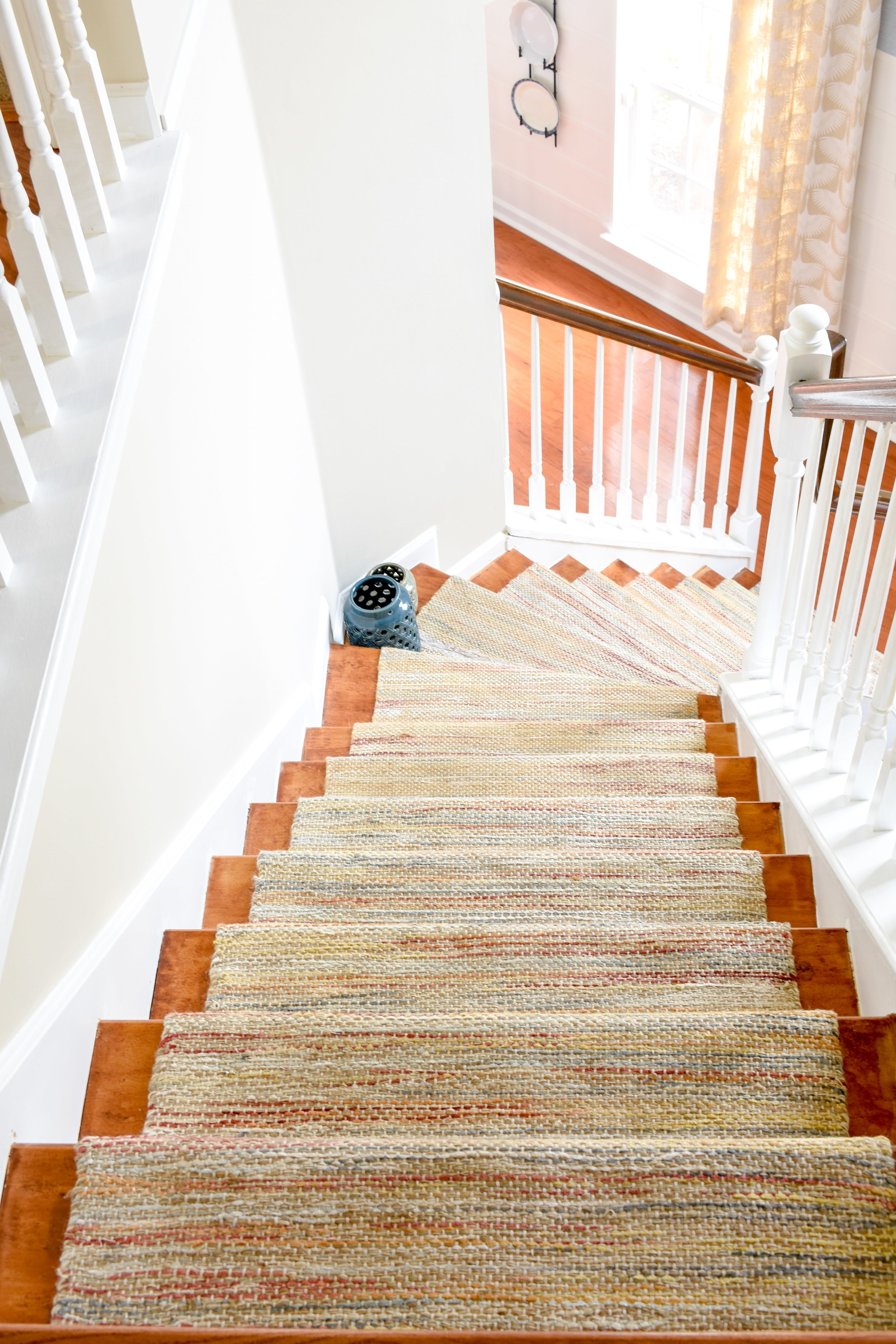 Our Suburban Home: Entryway updates include adding new hardwood on the stairs to replace the old carpet. #newhomeideas #suburbanhomes